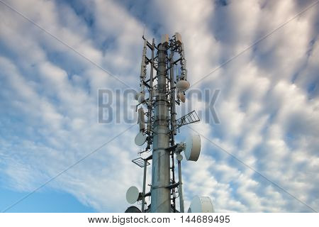 High Tech Sophisticated Electronic Communications Tower in the morning.
