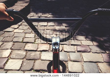 Black Handlebar Of Bmx Bicycle In Summer Day