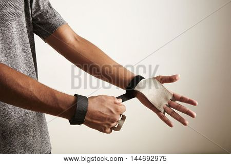 Young Athlete Putting On Cross Fitness Leather Hand Protectors