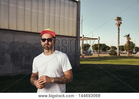 Tattooed Man In Blank T-shirt With Paper Coffee Cup