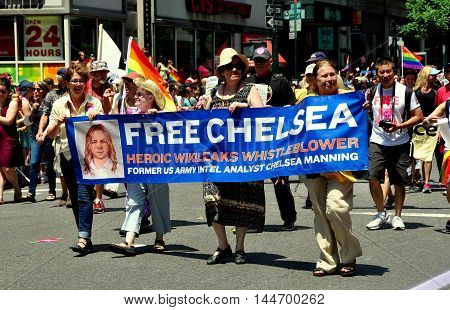 New York City - June 29 2014: Marchers with banner for Chelsea Manning a Wikileaks whistleblower marching at the 2014 Gay Pride Parade on Fifth Avenue