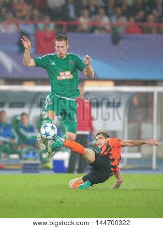 VIENNA, AUSTRIA - AUGUST 19, 2015: Robert Beric (SK Rapid) and Taras Stepanenko (FC Shakhtar) fight for the ball in an UEFA Champions League qualification game.