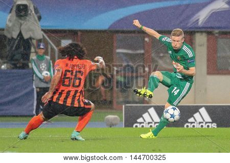 VIENNA, AUSTRIA - AUGUST 19, 2015: Marcio Azevedo (FC Shakhtar) and Florian Kainz (SK Rapid) fight for the ball in an UEFA Champions League qualification game.