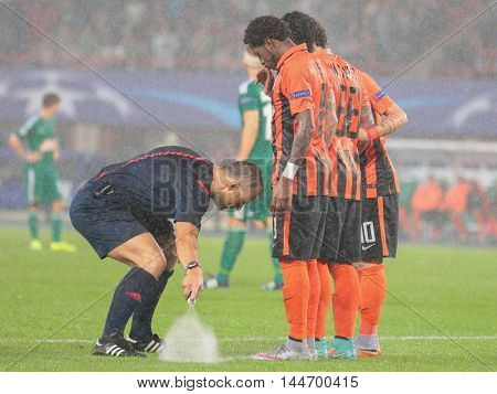 VIENNA, AUSTRIA - AUGUST 19, 2015: Referee Bjoern Kuipers marks the line in an UEFA Champions League qualification game.