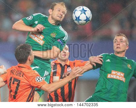 VIENNA, AUSTRIA - AUGUST 19, 2015: Maksym Malyshev (FC Shakhtar) and Mario Sonnleitner (SK Rapid) fight for the ball in an UEFA Champions League qualification game.