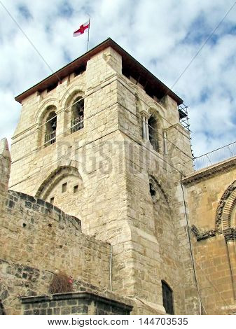 Jerusalem Israel - December 3 2012:Bell Tower with flag of Church of the Holy Sepulcher.