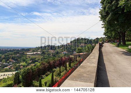 View From Park In Citta Alta To Hill San Vigilio Panorama In Bergamo, Italy