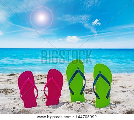 colorful flip flops on the sand in Sardinia Italy