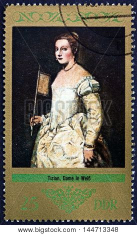 GERMANY - CIRCA 1973: a stamp printed in Germany shows Lady in White Painting by Titian circa 1973