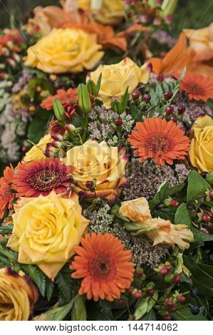 A Bouquet with yellow roses and orange gerbera