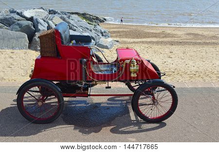 FELIXSTOWE, SUFFOLK, ENGLAND -  MAY  01,2016:  Vintage 1902 Stanley CX Steam Car parked on seafront promenade .