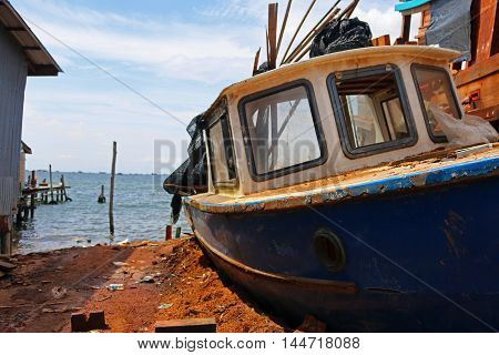 Wooden boat constraction in Cambodia old ship on the stocks Fisher boat on the sea