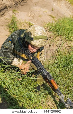 Lviv Ukraine - July 6 2016: Ukrainian-American joint military exercises near the Lviv rapid trident 2016. Commando ready to fire from the AK -74 at simulated enemy positions Lviv.Ukraine.