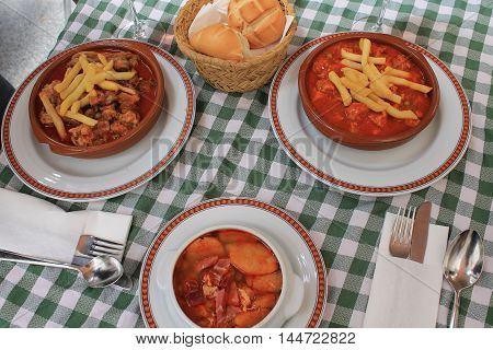 traditional Spanish second main dish, meat with vegetables