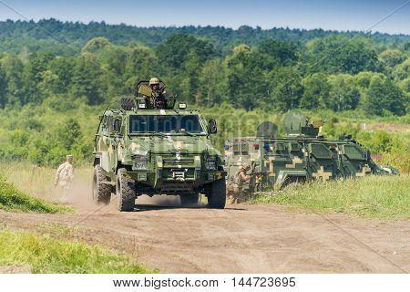 Lviv Ukraine - July 6 2016: Ukrainian-American joint military exercises near the Lviv rapid trident 2016. Ukrainian military vehicle KrAZ Spartan with comandos attack simulated enemy Lviv.Ukraine.