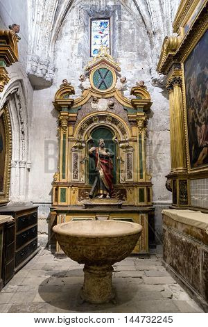 CUENCA SPAIN - August 24 2016: Interior of the Cathedral of Cuenca baptismal Chapel also called Chapel of San Antolin or Cabrera is the oldest of the Cathedral built in century XIV the central figure is San Ignacio Cuenca heritage of humanity Spain