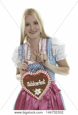 Woman with German Oktoberfest Ginger Bread heart