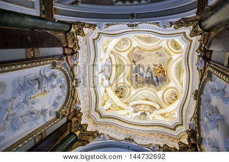 CUENCA SPAIN - August 24 2016: Interior of the Cathedral of Cuenca Capilla del Pilar central part of the vault of the lantern of the Chapel painting in fresco of the coronation of the Virgin. Cuenca heritage of humanity Spain
