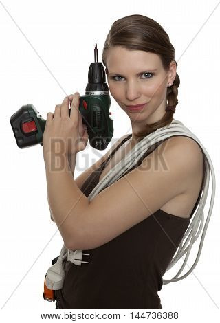 Young craftswoman with drill in front of white background