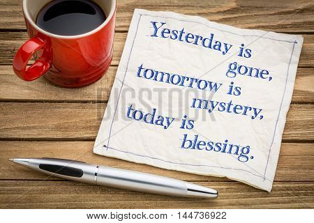 yesterday is gone, tomorrow is mystery, today is blessing - handwriting on a napkin with a cup of espresso coffee