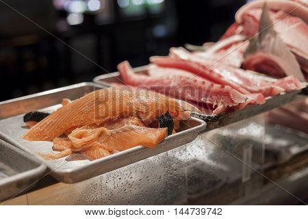 Prepared raw sushi grade fish awaits dinner service.