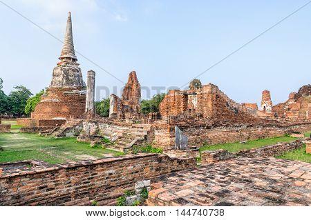 Ancient ruins of pagoda at Wat Phra Mahathat temple is a famous attractions in Phra Nakhon Si Ayutthaya Historical Park Thailand