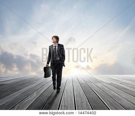 Businessman walking on a wooden floor