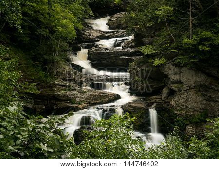 Cullasaja Falls waterfall with blurred motion cascading down the rocks on the Mountain Water Scenic Byway near Highlands in North Carolina USA