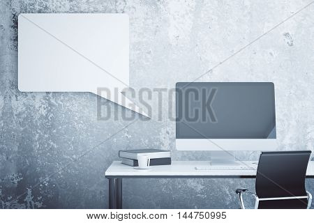 Creative workplace with empty computer monitor book coffee cup swivel-chair and abstract speech bubble on textured concrete wall background. Mock up 3D Rendering