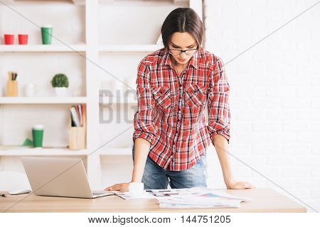 Pretty Young Woman Doing Paperwork