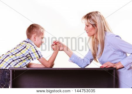 Spending time with family fun and family bonds. Mother and son arm wrestle and have fun indoors. poster