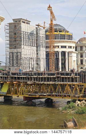 SKOPJE MACEDONIA - SEPTEMBER 17: Building Bridge Over Vardar River in Skopje on SEPTEMBER 17 2012. Construction Site of Big Cultural Project in Skopje Macedonia.