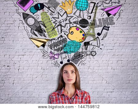 Girl On Brick Background With Drawings