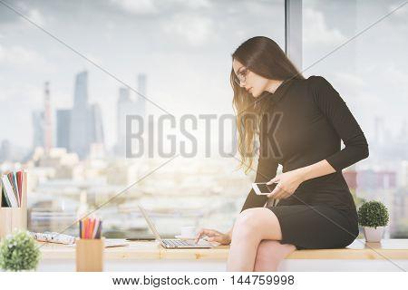 Woman On Windowsill Using Laptop