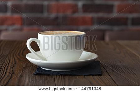 cup of cappuccino, coffee cup, cup of coffee on a brown wooden table