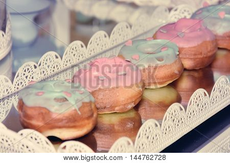 Five multicolor donuts with focus on one