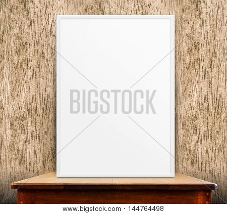 Empty White Frame On Wooden Table At Wood Wall In Background,mock Up For Adding Your Design,