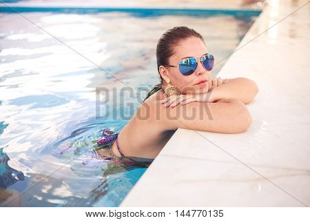Beautiful Woman Relaxing In Swimming Pool Water In Resort Spa Hotel On Travel Holidays Vacation