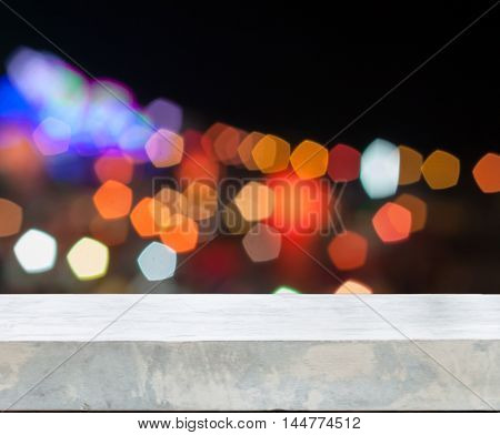 Concrete tabletop with abstract blurred lights, stock photo