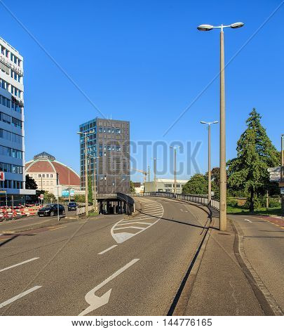 Basel, Switzerland - 27 August, 2016: Markthallenbruecke street bridge view from Nauenstrasse street. Markthallenbrucke is located in the center of the city of Basel, it is about 812 meters long and it has a cycleway.
