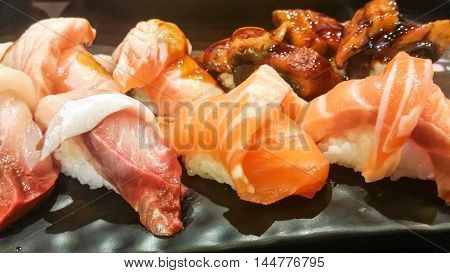 the variety sushi on the black plate