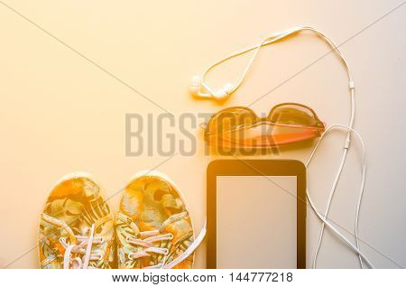 The Colorful Canvas Shoe, White Earphone With Sunglasses And Tablet On White Background With Warm To