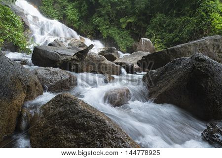 Waterfall in deep forest in national park in Chanthaburi, Thailand