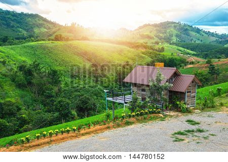 Home foothill with beautiful green nature of meadows, forests and mountains.