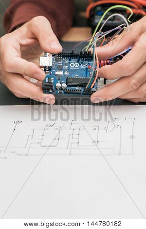 UKRAINE, KHARKIV, AUGUST 25, 2016. Electronic construction on base of Arduino UNO platform with wiring engineering diagram close-up. Arduino UNO is an open-source electronics platform.