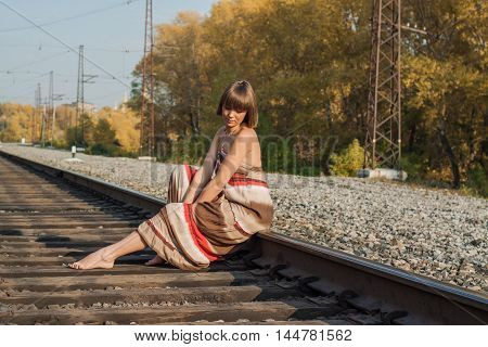 Beautiful Girl Sitting On Railroad Track.