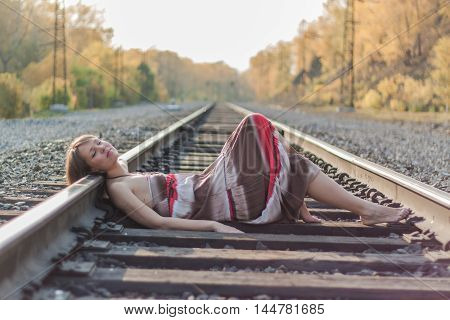 Beautiful Girl Laying On Railroad Track.