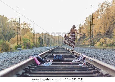 Beautiful Girl Walking On Railroad Track.