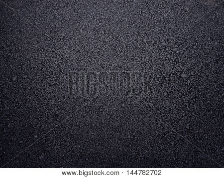 Street surface background. Rough asphalt road textured.