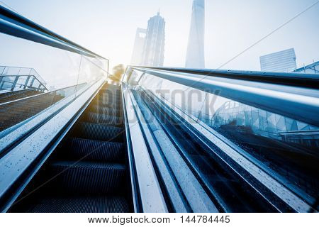 empty escalator and jin mao tower at shanghai square